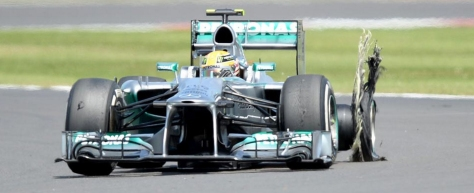 Lewis-Hamilton-with-a-burst-tyre